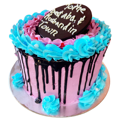 pink and blue themed drip cake
