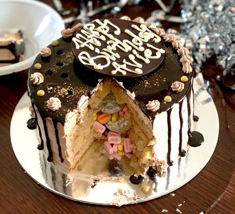 pinata cake filled with candy and chocolate coins