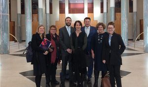 Several members of the Alliance are standing in the marbled Parliament House foyer.
