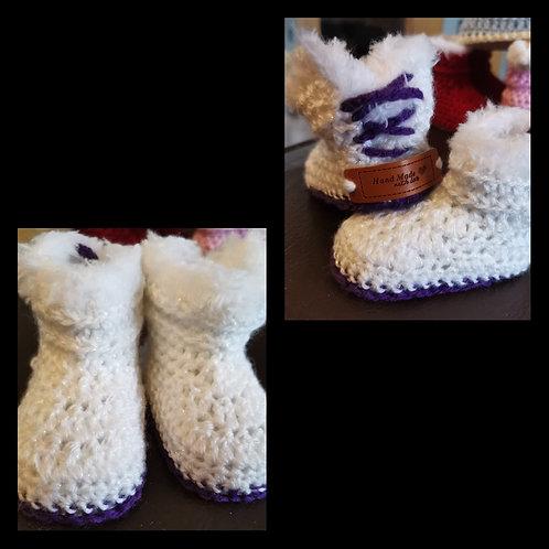 white and purple baby padder boot