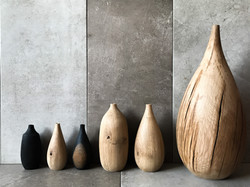 Oak vases designed and carved by hand by