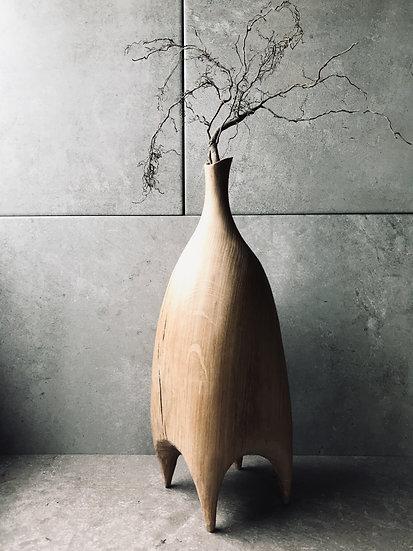 Carved oak vase on legs