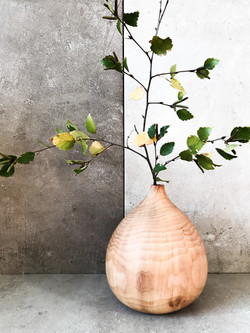 Carved wood vase by UK craftsman and woo