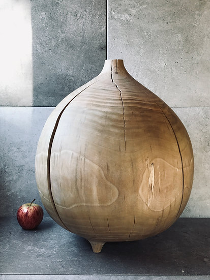 A large, round vase in cherry