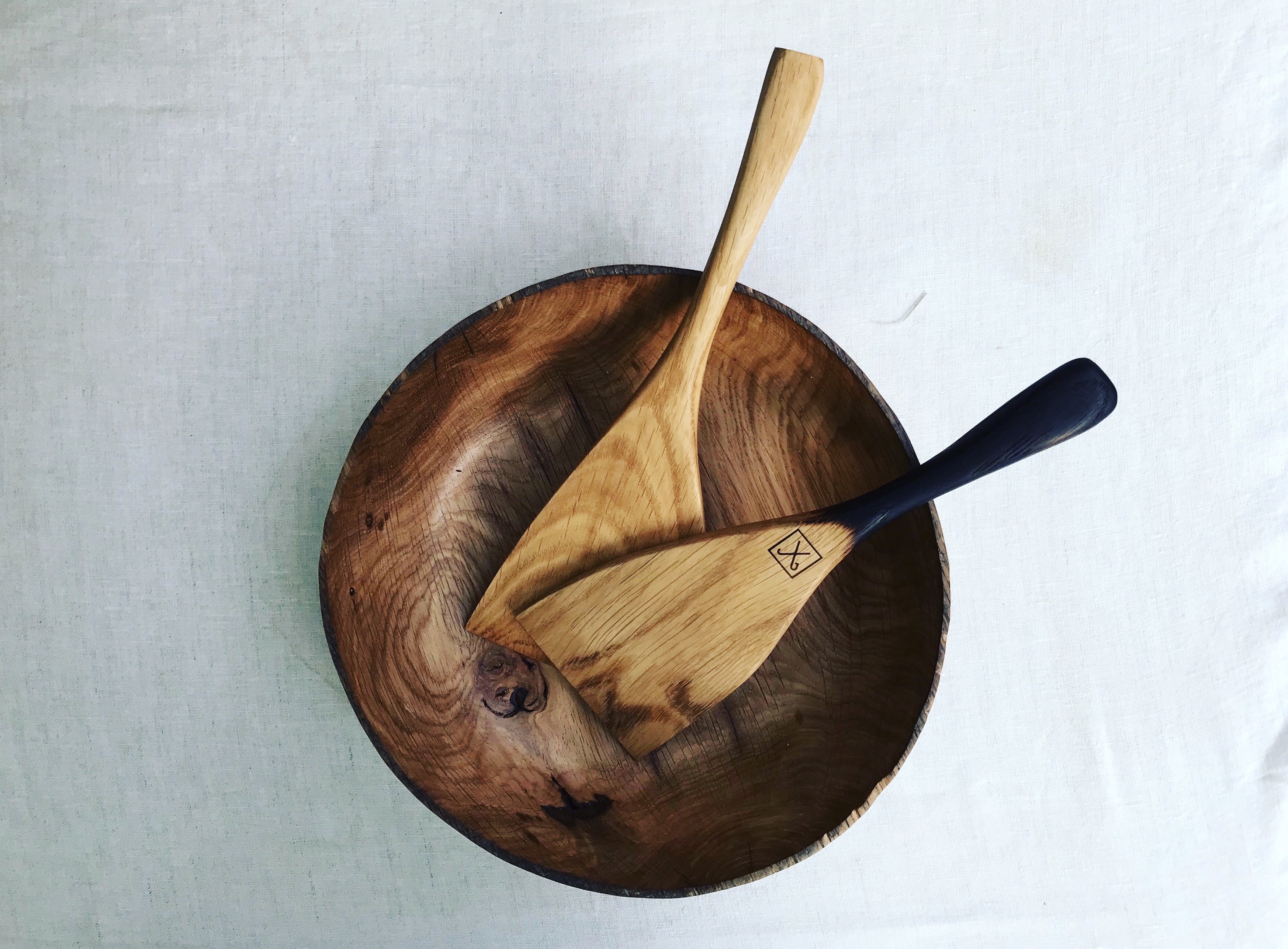 Hand carved oak bowl from oak by Jamie Gaunt. Wooden kitchen utensils handmade from oak with scorche