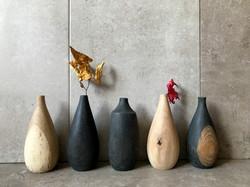 Mini series of carved oak vases