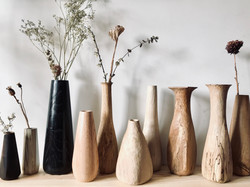 Hand carved flower vases by craftsman an