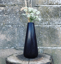 Scorched oak flower vase hand made by wood worker Jamie Gaunt in the UK