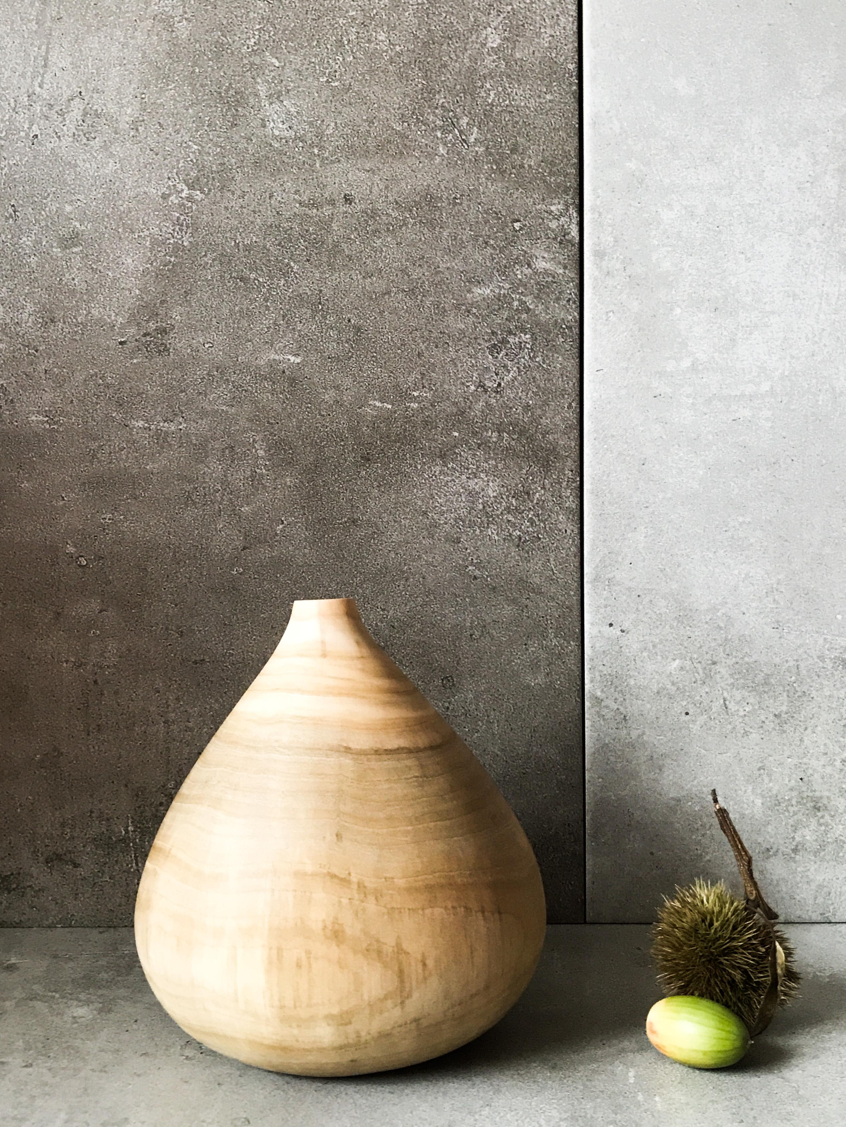 Carved wood vase by designer and maker J