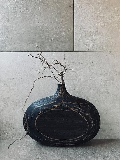Ebonised vase in oak