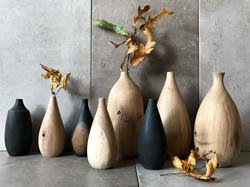Carved oak vases by UK craftsman and woo