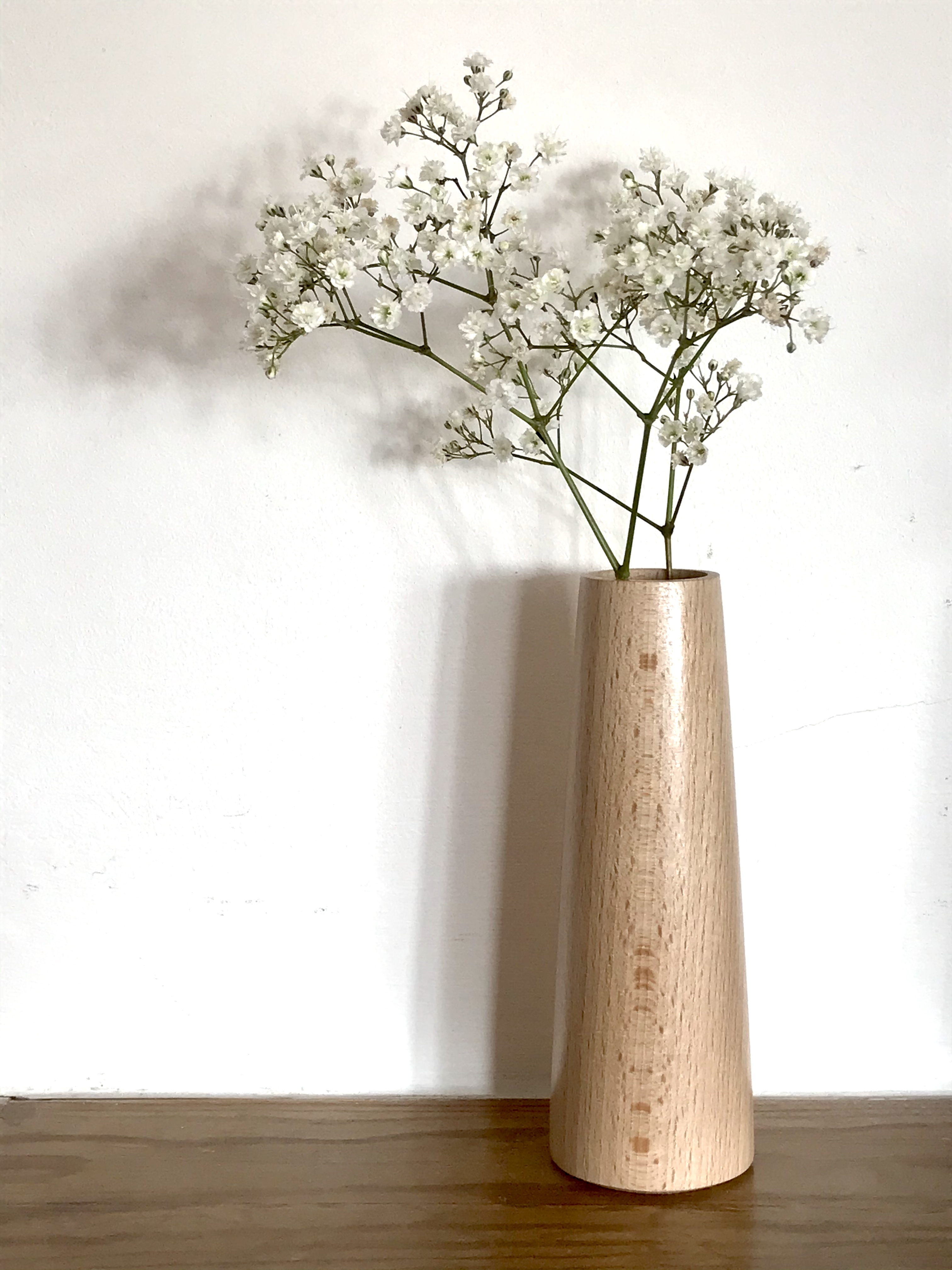 A small hand carved vase from a beech wood for flowers