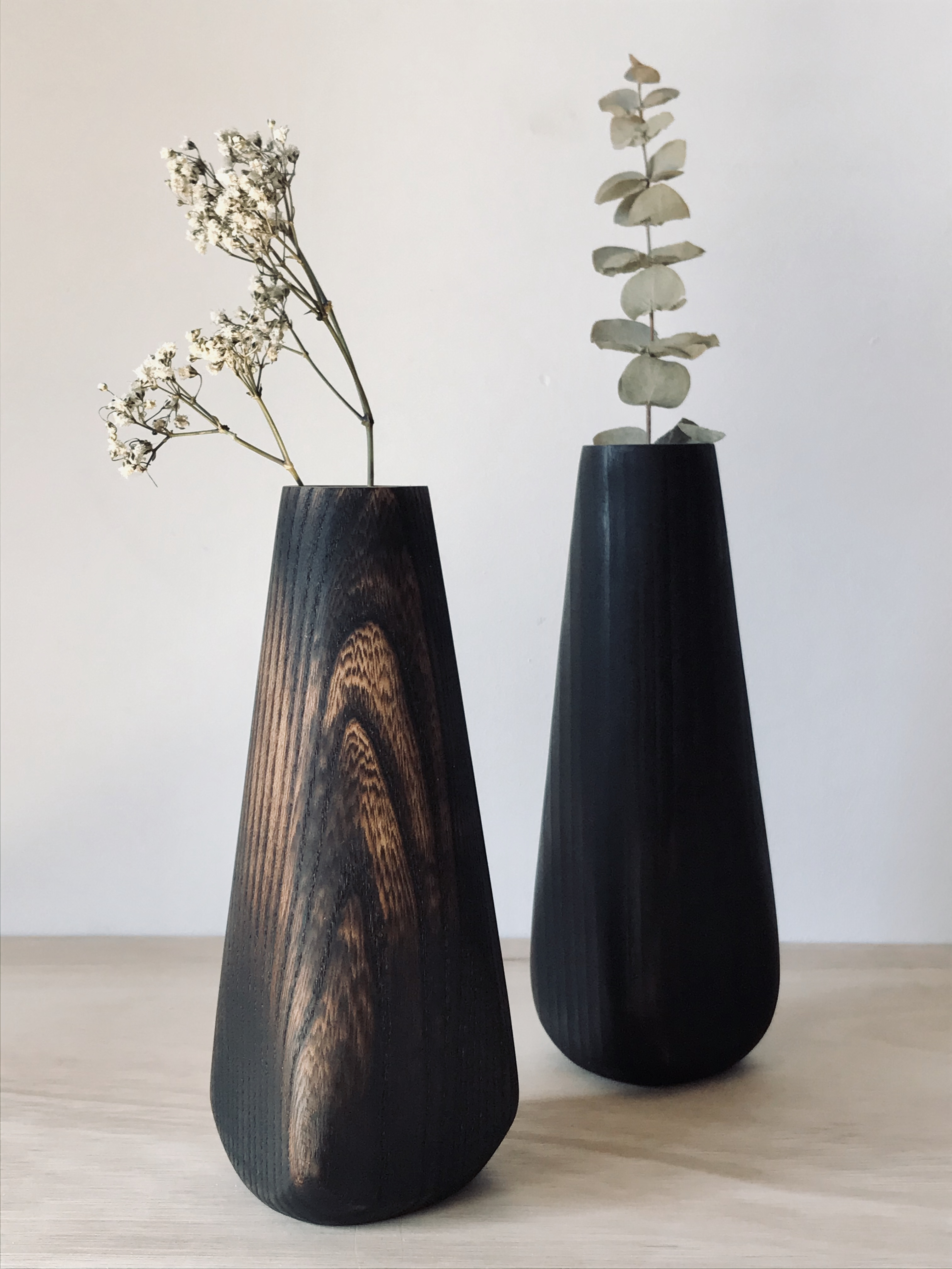 A pair of scorched wood vases hand carved by Jamie Gaunt