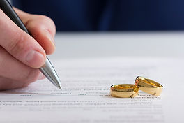 Hands of wife, husband signing decree of