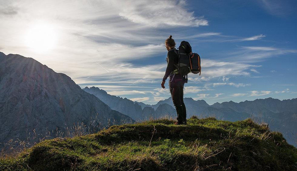 male-hiker-enjoying-majestic-sunrise-in-