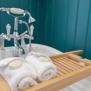 Baths have traditional shower attachments