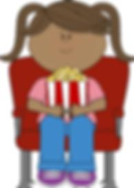 bambina che mangia al cinema