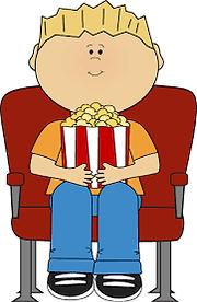 bambino che mangia al cinema