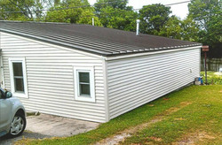 NEW METAL ROOF & SIDING - AFTER.
