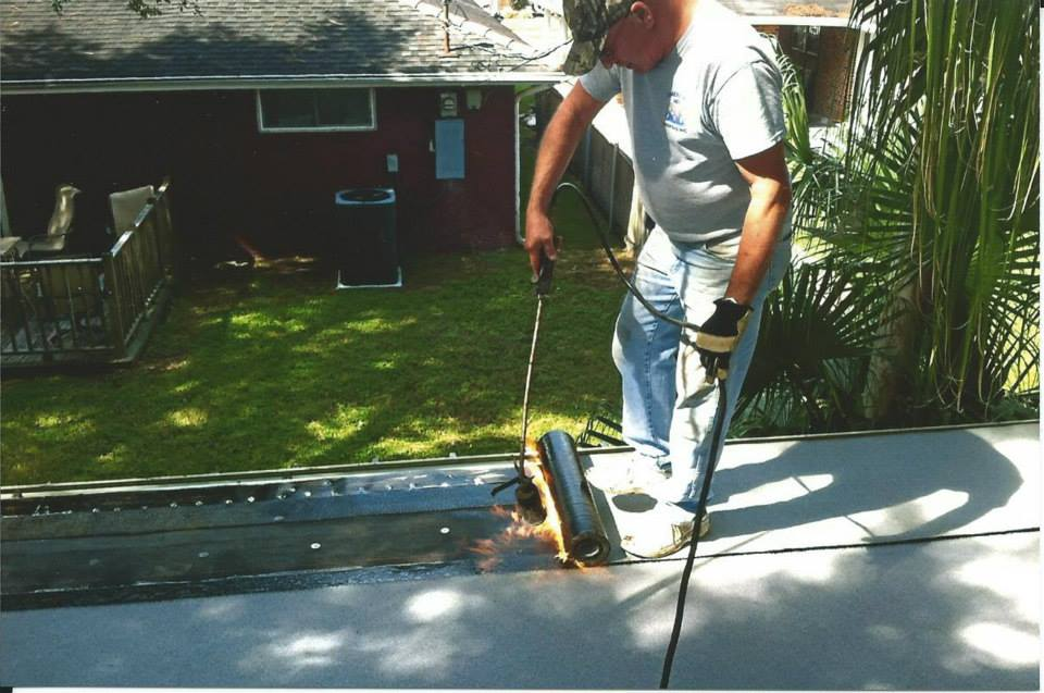 TORCHING DOWN A FLAT ROOF