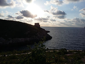 Xlendi Tower at Dusk.jpg