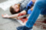 Applying first aid to the injured bleedi