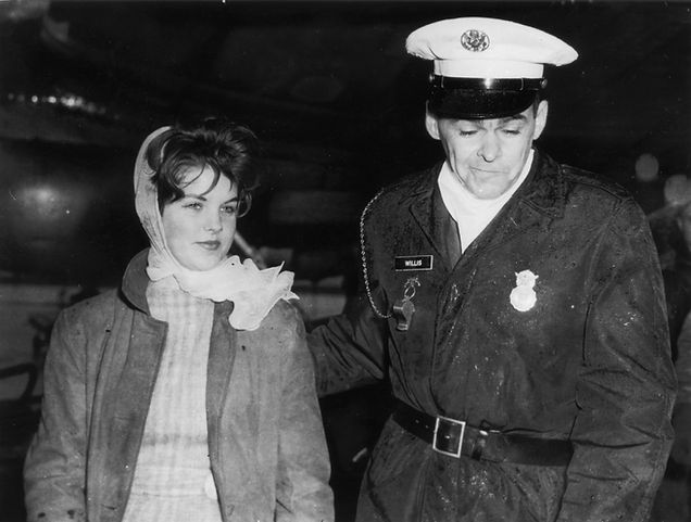 Fourteen-year-old Priscilla Beaulieu is led away by a military policeman whilst trying to say goodbye to her friend Elvis Presley at Frankfurt Airport, 2nd March 1960.