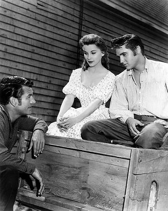 Film scene Love Me Tender with Richard Egan and Debra Paget.