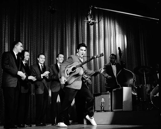 Elvis performs with The Jordanaires duri