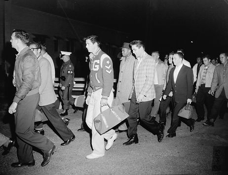 March 25, 1958. Arrival by bus at Fort Chaffee.