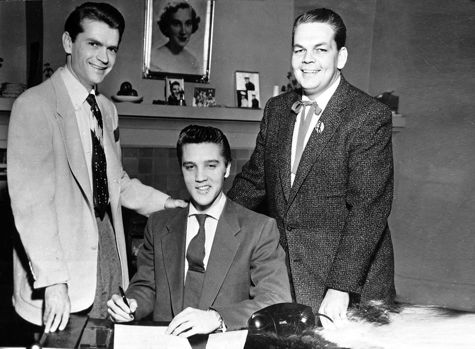 Sam Phillips and  Bob Neal with Elvis. January 1, 1955. Photographed by Papa Lou at his re