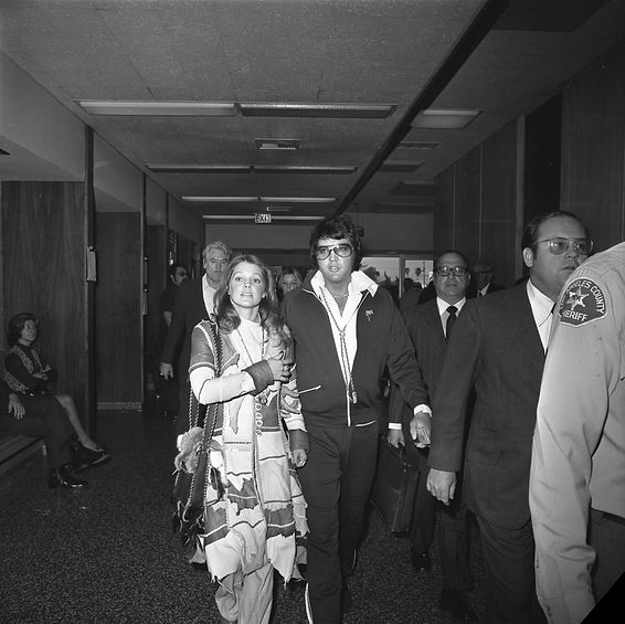 Elvis and Priscilla Presley leaving cour