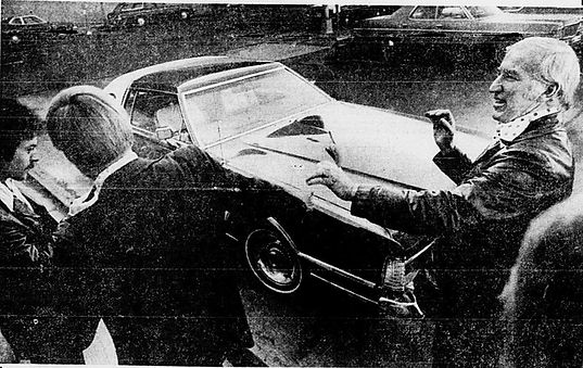 Colorado - Denver police Captain Kennedy with his Lincoln Mark VI.