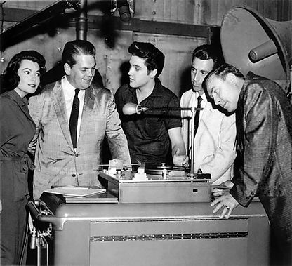 Jailhouse Rock soundstage with Judy Tyler, ex manager Bob Neal, Elvis unknown and Memphis