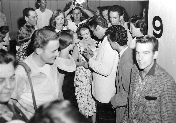 Elvis, Anita Wood signing autographs at
