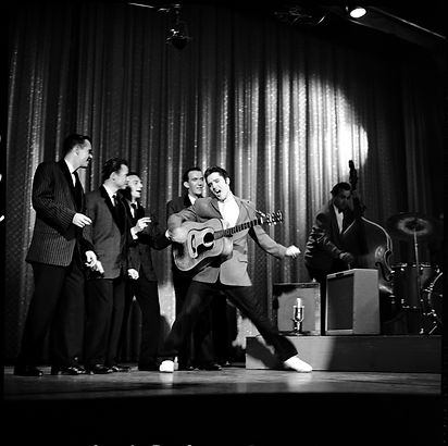 Elvis performs with The Jordanaires during an October 28, 1956 appearance on The Ed Sullivan Show.