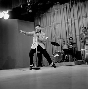 "Performing ""Hound Dog"" on June 5, 1956 at The Milton Berle Show. Burbank Studios, Hollywood, Ca."
