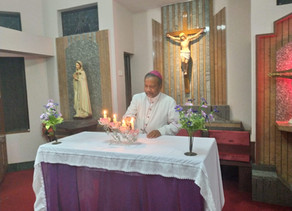 Archbishop Peter Machado joins the Nation in lighting the lamp