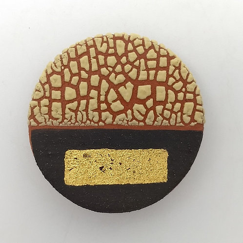Deep Yellow Glazed Terracotta and Black Slip Brooch with Gold Leaf