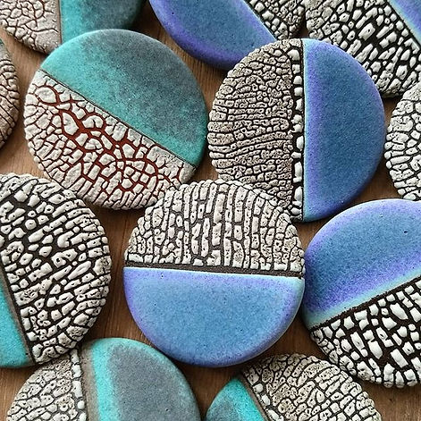 Ceramic handmade brooches decorated with textured glazes.