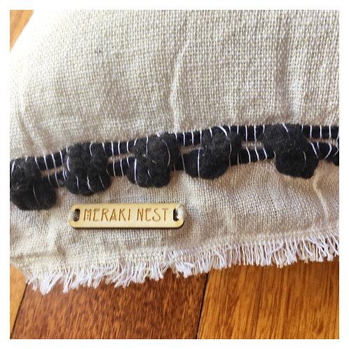 Raw cotton pompom cushion