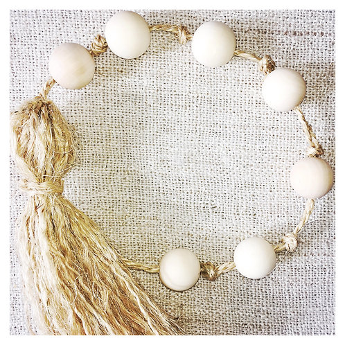 Raw timber beaded garland with tassel