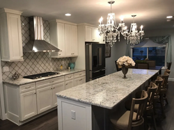 White kitchen with chandelier