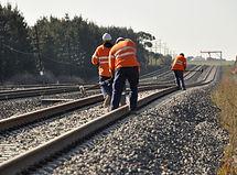 Railway Workers repairing railway on hot