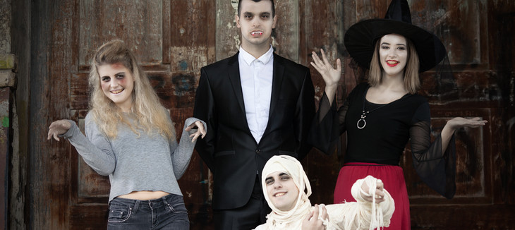 Zombie, vampire, witch and mummy standin