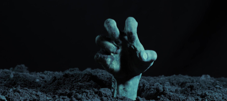 Zombie hand rising out from the grave.mo