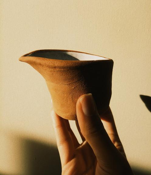 Terracotta pourer