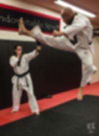 Chief Master Dan Lovas doing a jump cresent kick.