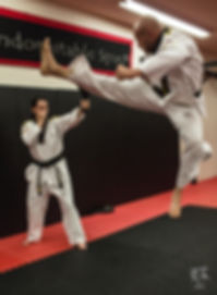 Chief Master Dan Lovas doing a jump cresent kick.
