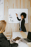 woman-pointing-at-whiteboard-3727511 (1)